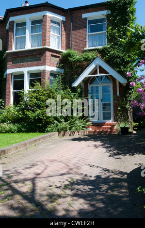 A late-nineteenth century semi-detached house in South London with a brick paved drive or pull-in. - Stock Photo