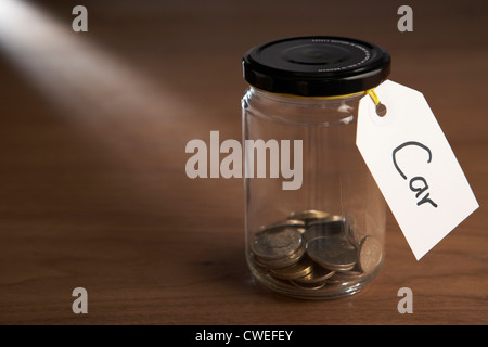 Coins in a jam jar - Stock Photo