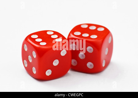 Pair of red dice thrown to a double six, isolated on a white background - Stock Photo