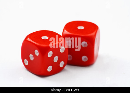 Pair of red dice thrown to show snake eyes, isolated on a white background - Stock Photo