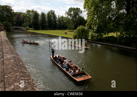 Cambridge England,UK. Punts and Punting along The Backs of the River Cam also known as the Granta. - Stock Photo