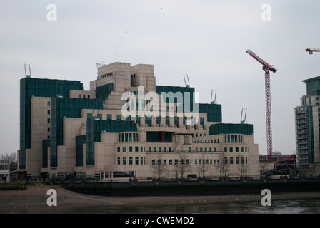 The SIS Building otherwise know as Vauxhall Cross the home of MI6 / SIS with tower cranes against a grey sky - Stock Photo