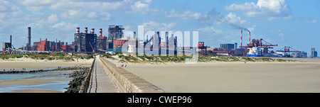 View over heavy industry seen from the beach at Dunkirk / Dunkerque, Nord-Pas-de-Calais, France - Stock Photo