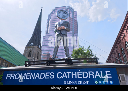 Mannequin with clock head at Les Promenades de la Cathédrale in downtown Montreal. - Stock Photo