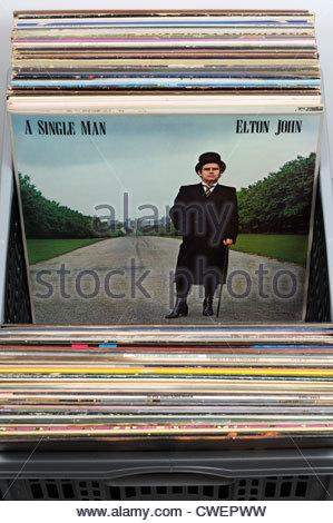 Box of secondhand LP records, Elton John album A Single Man, England - Stock Photo