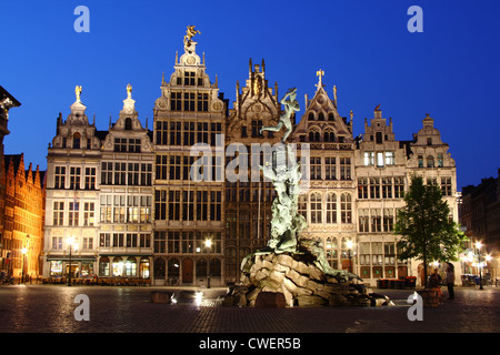 night scene: sculpture of Brabo and the guild houses as a background at the main square Grote Markt of Antwerp, - Stock Photo