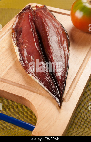 A whole dried bonito waiting to be served - Stock Photo