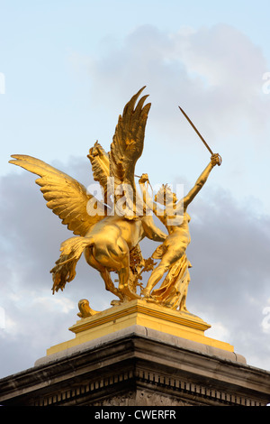 Statue on the Pont Alexandre III Bridge, Paris,France - Stock Photo