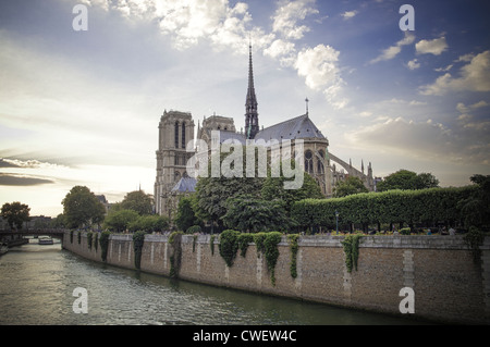 Notre Dame Cathedral at sunset, view across the Seine river. Paris, France. - Stock Photo