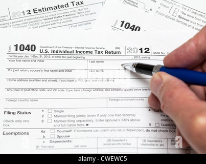Income tax 1040 us individual tax return form and magnifying glass ...