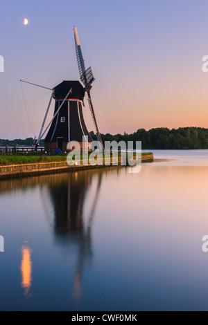 Windmill De Helper at Paterswoldsemeer just after sunset, near Haren in the Province of Groningen, Netherlands - Stock Photo