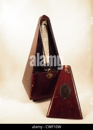 An old and wooden metronome from the collection of my parents - Stock Photo