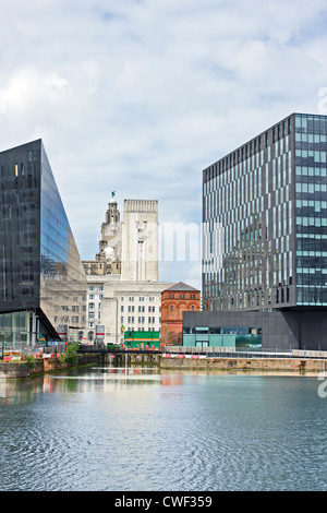 A view of the historic Liver Buildings in Liverpool, Merseyside, flanked by modern office blocks with the Albert - Stock Photo