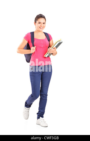 Full length portrait of a female student holding books isolated on white - Stock Photo