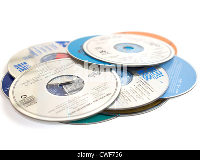 Music CDs. A pile of music compact discs on a white background - Stock Photo