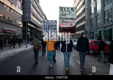 Anti Acta demonstration in Berlin. Protesters hold signs. - Stock Photo
