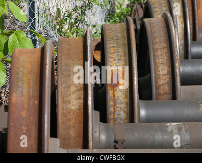 Closeup of wheels rusting while waiting to be used for train maintenance - Stock Photo
