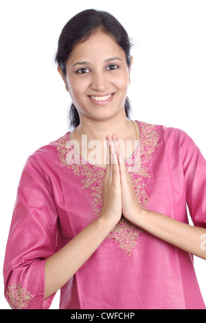 Young Indian woman greeting 'NAMASHE' - Stock Photo