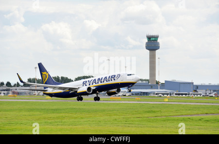 ryanair jet taking off with the air traffic control tower in the background. east midlands airport england uk - Stock Photo
