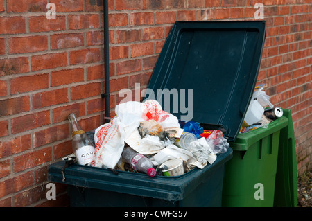 An overflowing rubbish bin, Shifnal, Shropshire, England - Stock Photo