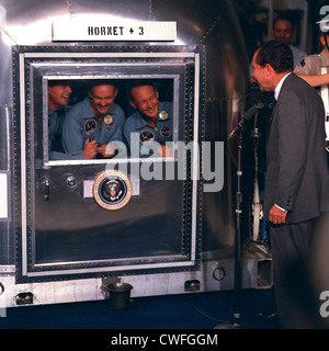 US President Richard Nixon welcomes the Apollo 11 astronauts home aboard the USS Hornet after returning from their - Stock Photo