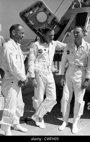 The prime crew of the Apollo 11 lunar landing mission relaxes on the deck of the NASA Motor Vessel Retriever prior - Stock Photo