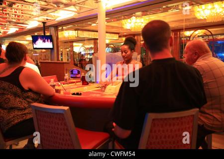 Visitor playing poker in Las Vegas, Nevada, US - Stock Photo
