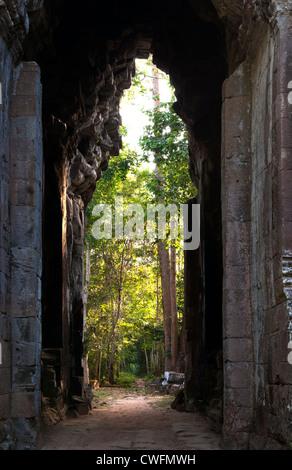 Early morning, looking eastwards through Angkor Thom East Gate, Angkor, Cambodia - Stock Photo