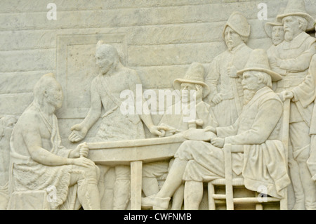 National Monument to the Forefathers, carving detail showing pilgrims with native Americans - Stock Photo