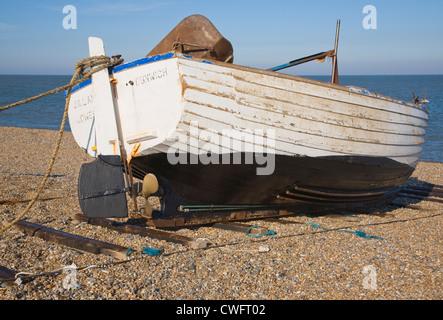 Small fishing boat Dunwich beach Suffolk England - Stock Photo