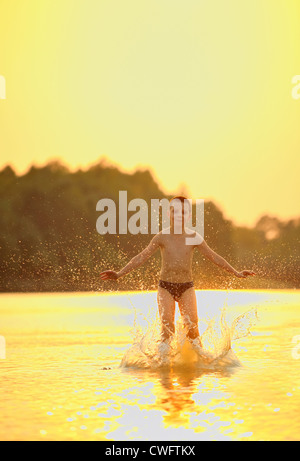 boy jumping in river - Stock Photo