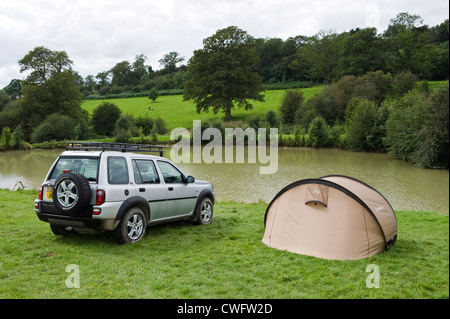 Land Rover Freelander camping at lakeside in countryside at Herefordshire England UK - Stock Photo