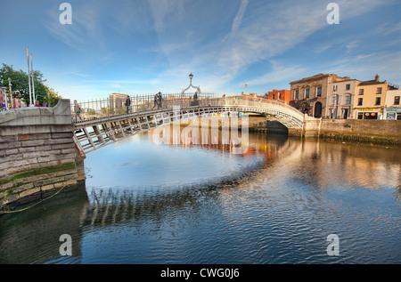 The Halfpenny Bridge over the River Liffey in Dublin, Ireland in Summer - Stock Photo