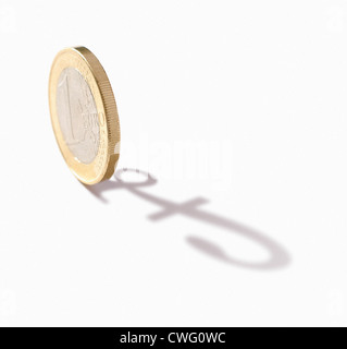 close-up of euro coin, casting the shadow of a pound sign - Stock Photo