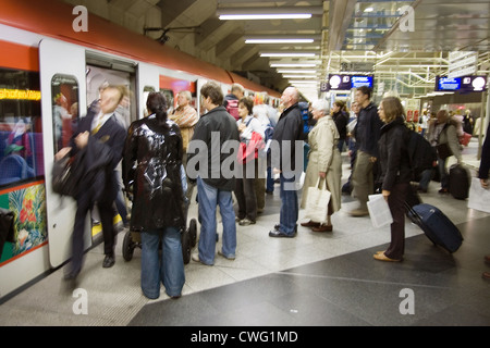 Muenchen, Passengers in entering the S-Bahn - Stock Photo