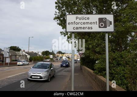 cars passing police enforcement camera warning sign edinburgh, scotland, uk, united kingdom - Stock Photo
