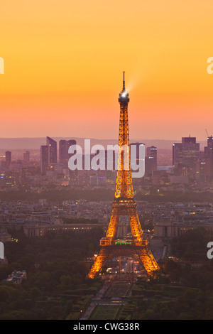 Paris skyline at sunset showing the Eiffel tower and surrounding areas France EU Europe - Stock Photo
