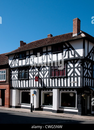 Strada shop medieval black and white half timbered medieval building on corner of Ely Street and High Street Stratford - Stock Photo