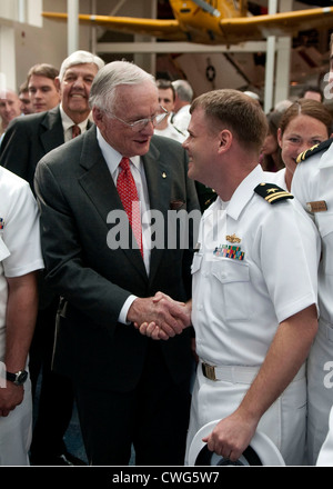 Former astronaut Neil Armstrong is congratulated by Lt. Gavin Clough, from San Diego, Calif. after Armstrong's induction - Stock Photo