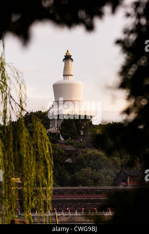 View at sunset of the White Dagoba Tibetan style stupa in Beihai Park in Beijing, China - Stock Photo