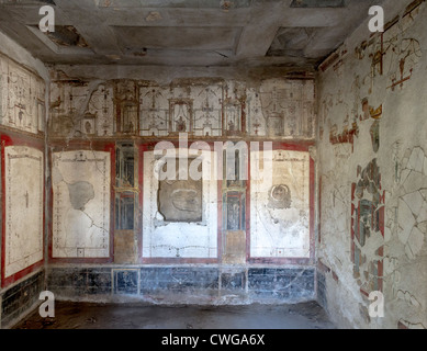 Ancient Roman mural at the excavated city of Pompeii showing architecture in perspective (House of Octavius Quartio) - Stock Photo