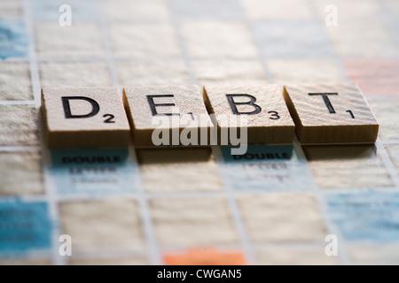 Letter tiles spelling the word - Stock Photo
