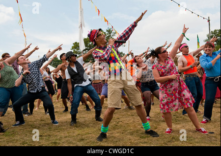 Wilderness Festival 2012, Cornbury, UK. Kester Francis and Pippa Tooher of Swing Patrol lead a swing dance class - Stock Photo