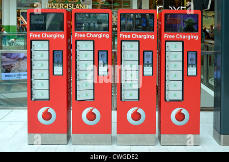 Free mobile phone charging lockers in shopping Mall at the Westfield Stratford City complex - Stock Photo