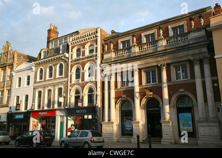 Historic buildings lining High Street, Colchester, Essex, England - Stock Photo