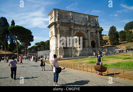 Rome, Italy - Tourists at the Arch of Constantine near the Colosseum. - Stock Photo
