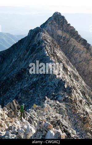 A man descending Capitol Peak, White River National Forest, Aspen, Colorado. - Stock Photo