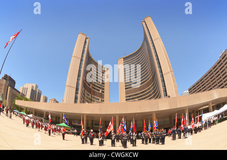 Canadian armed Forces parading beneath The City Hall, Toronto, Canada, celebrating 72nd. Anniversary of the Battle - Stock Photo