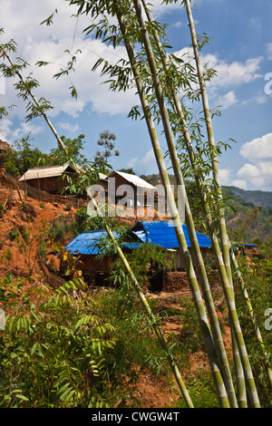 Houses with metal roofs in an ANN TRIBAL VILLAGE near KENGTUNG also known as KYAINGTONG - MYANMAR - Stock Photo