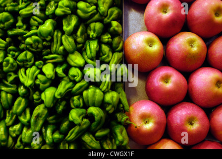 Scotch bonnet peppers and apples on sale in Spanish market - Stock Photo